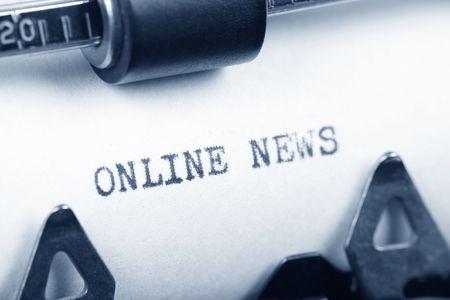 Typewriter close up shot, concept of Online News Reklamní fotografie