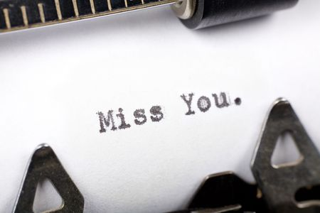 miss you: Typewriter close up shot, concept of Miss You