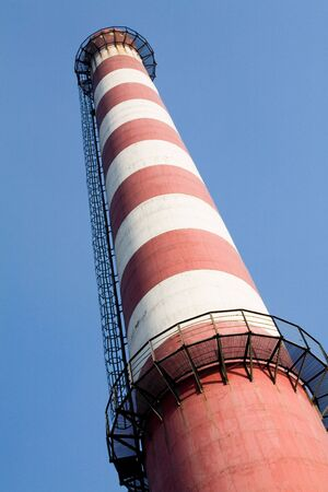 tall chimney: tall Chimney, the concept of industry Stock Photo