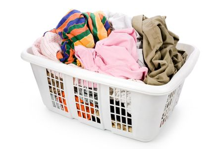 laundry basket and dirty clothing with white background photo