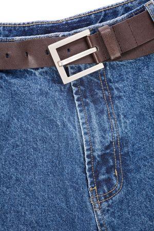 a blue jean and belt close up shot photo