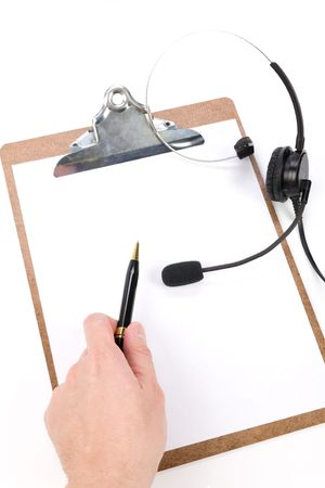 customer records: a black headset and clipboard close up
