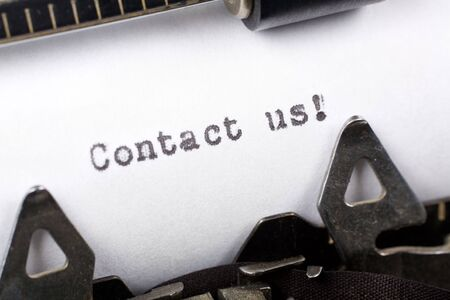 contato: Typewriter close up shot, concept of Contact us Banco de Imagens