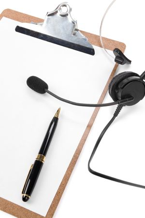 a black headset and clipboard close up