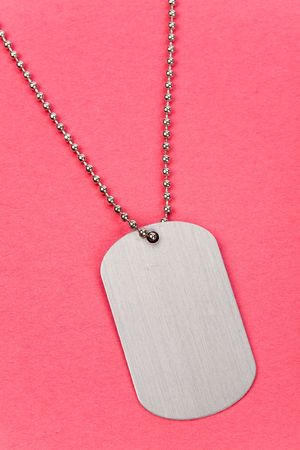 silver medal: Identity tag with chain close up shot