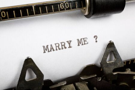 Typewriter close up shot, Concept of Marry me Stock Photo
