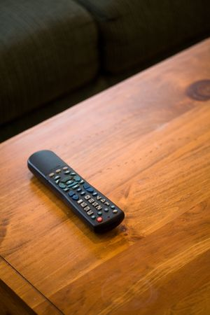 Remote Control and coffee table close up shot Stok Fotoğraf