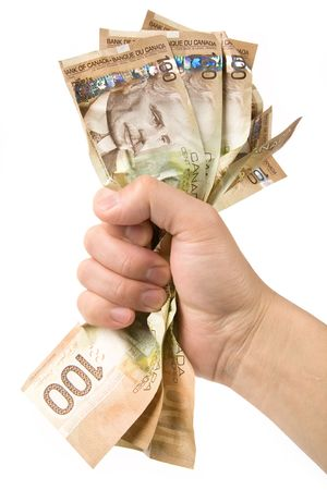 grabbing hand: a hand full of canadian dollars, financial concept Stock Photo