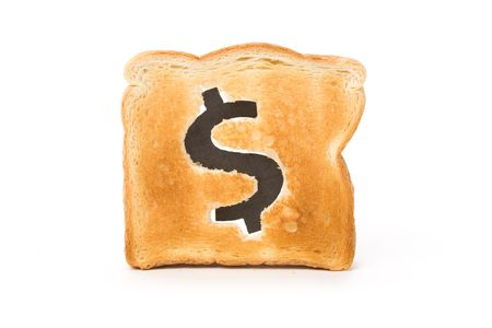 burnt toast: bread slice with dollar sign, concept high price of food or food for business