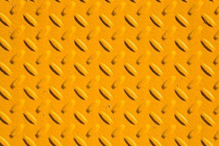 treads: yellow metal treads close up shot