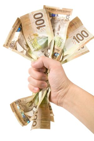 canadian currency: a hand full of canadian dollars, financial concept Stock Photo