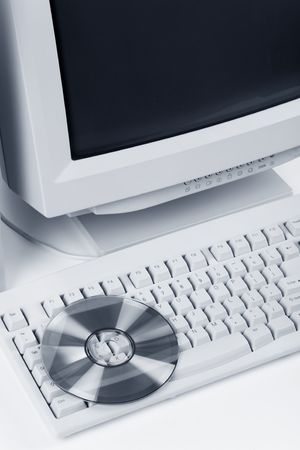 Desktop Computer and CD-ROM close up shot photo