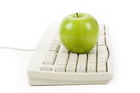 online: green apple and computer keyboard, concept of online learning