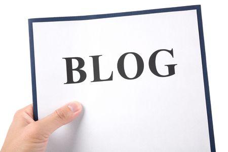 ブログ ファイル、インターネットを持っている手の日記の概念 写真素材