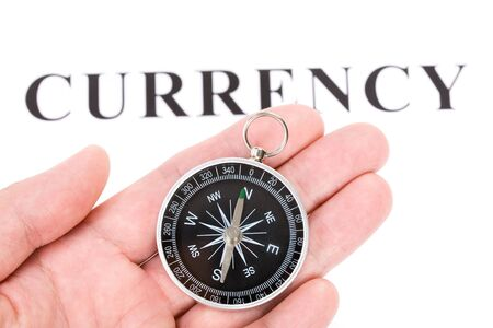 headline currency and Compass, concept of financial decision Stok Fotoğraf