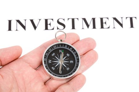 headline investment and Compass, concept of financial choice photo