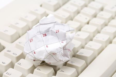 unorganized: Calendar paper ball and computer mouse, concept of time planning, Wasting Time, Unorganized