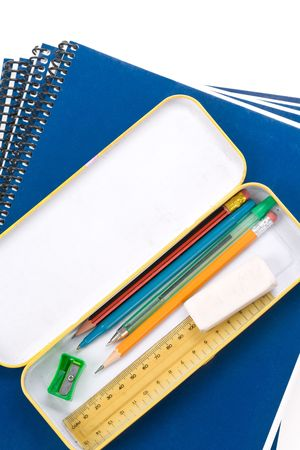 Metal pencil case and textbook with white background photo