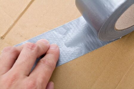 a roll of Grey Duct Tape close up shot