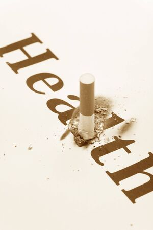 unhealthy living: A Cigarette Butt close up, concept of Unhealthy Living