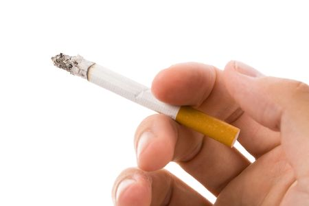 unhealthy living: A Cigarette with white background Stock Photo