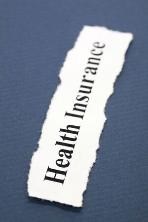 Headline of Health Insurance with blue background   Banco de Imagens
