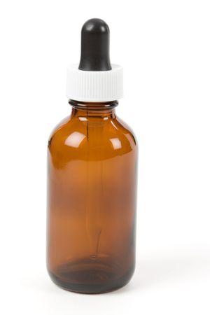 白い背景を持つドロッパー ボトル