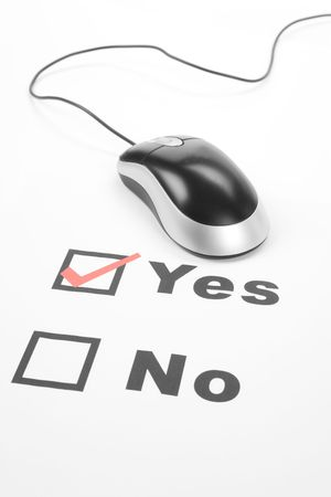 questionnaire and computer mouse, concept of online voting photo