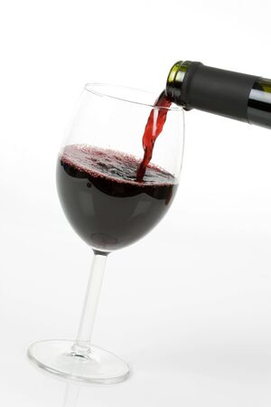 Red Wine Pouring Down to a Wineglass photo