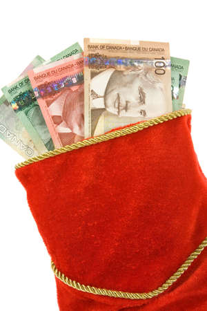 canadian currency: Christmas Stocking and canadian dollars, close up Stock Photo