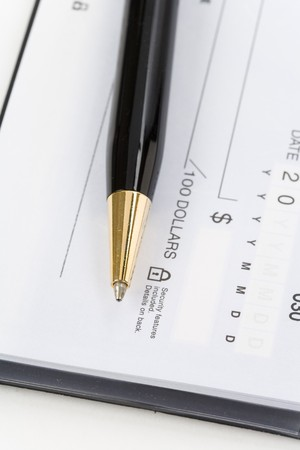 Checkbook and pen close up