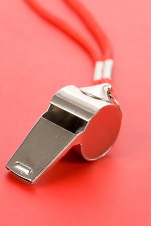 Un silbato, con fondo rojo Foto de archivo - 4033470