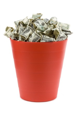 garbage can: Dollars in Red Garbage Can with White Background Stock Photo