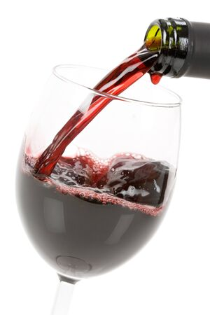 Red Wine pouring down to a wineglass Stock Photo - 4252536