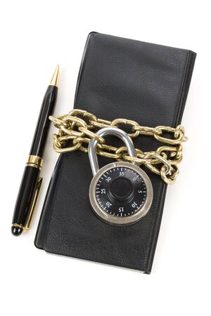Checkbook and Chain, concept of Recession or Safety Stock Photo