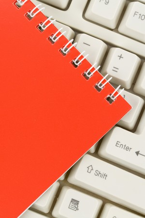 note pad: Red Note Pad and Keyboard close up Stock Photo