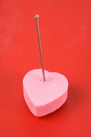 Pink Heart Shape Candy and pin, concept of Love Curse