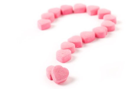 Pink Heart Shape Candy and Question Mark, Love Puzzle Stock Photo - 4367356