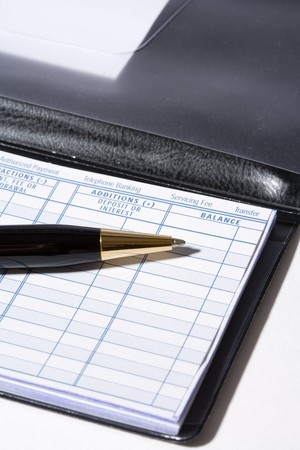 Checkbook and pen with white background