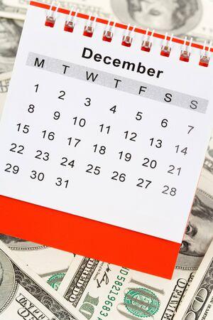 december: Calendar and dollar, December