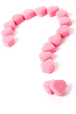 Pink Heart Shape Candy and Question Mark, Love Puzzle Stock Photo - 4457833
