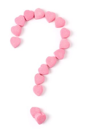 Pink Heart Shape Candy and Question Mark, Love Puzzle Stock Photo - 4487817