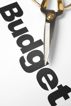 tekst van Begroting en schaar, concept van de begroting gesneden Stockfoto