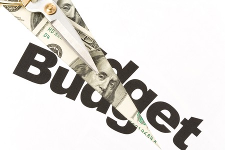 text of Budget and scissors, concept of Budget cut photo