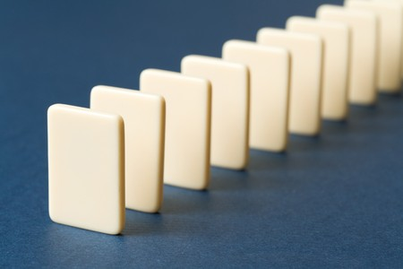 Domino with blue background, Concept of Cause or Teamwork photo