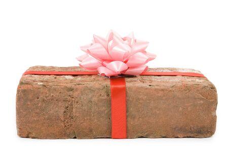 prank: Red Brick Gift, Concept of joke, make fun of somebody, gift on April Fools Day, Prank gift
