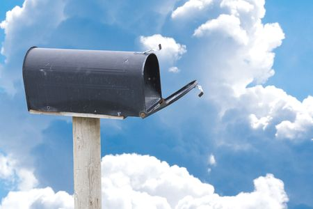 Black Mailbox and blue sky