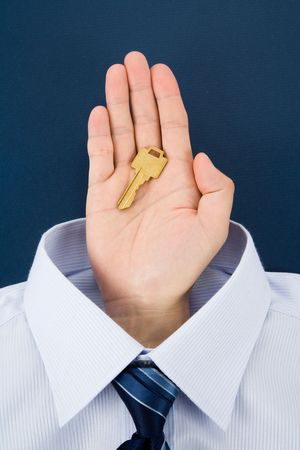 Hand holding a golden key, Business Concept Stock Photo