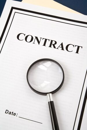 Business Contract and magnifier close up photo