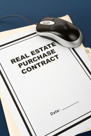 purchase: Real Estate Purchase Contract and computer mouse, business concept Stock Photo